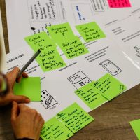 Post its on Top of Service 'tube journey at night' with person looking at them