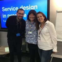 Picture of Martin Jordan, Clara Greo and Emma Thomas in front of Service design training slide